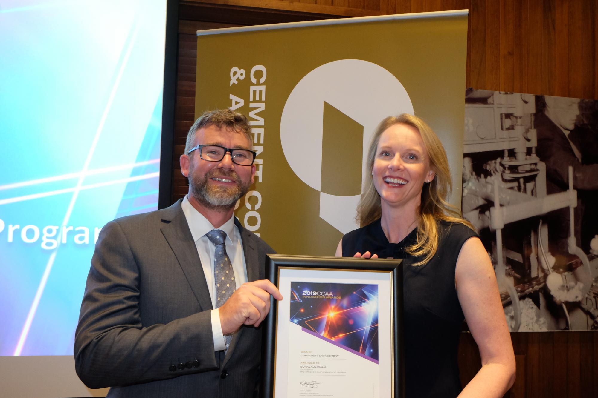 Pictured: Tasmanian Minister for Resources, Building and Construction, Sarah Courtney, presenting Boral Tasmania General Manager Gary Chapman with the award in Hobart on May 24, 2019