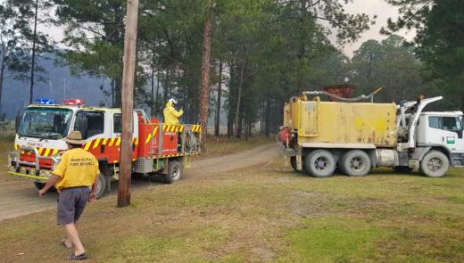 Boral's water cart delivers water to fire trucks responding to a fire near Johns River township in NSW